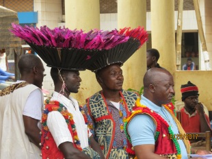 Members of a Yemba literacy class wearing traditional hats for the dance that will accompany the entry of the New Testament