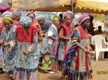 """Women perform traditional dance and sing a new song, incuding the words """"God is here!"""""""